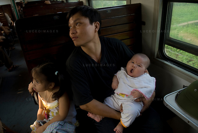 A family rides the train from Hanoi to Sapa, Vietnam.