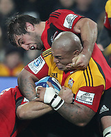 Crusaders' Samuel Whitelock tackles Chiefs' Hika Elliot in a Super Rugby match, Waikato Stadium, Hamilton, New Zealand, Friday, July 06, 2012.  Credit:SNPA / David Rowland