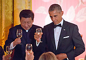 United States President Barack Obama and and President XI Jinping of China exchange toasts during a State Dinner in the East Room of the White House in Washington, DC on Friday, September 25, 2015.<br /> Credit: Ron Sachs / CNP