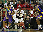 Louisville's Terry Rozier (0) heads up court after taking a rebound from  Northern Iowa State's Deon Mitchell (1) during the 2015 NCAA Division I Men's Basketball Championship's March 22, 2015 at the Key Arena in Seattle, Washington.  Louisville beat Northern Iowa State 66-53 to advance to the Sweet 16.  ©2015. Jim Bryant Photo. ALL RIGHTS RESERVED.