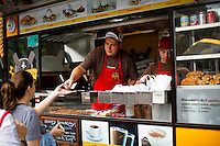 People works in a fast food street car at east lower Manhattan in New York. October 6, 2012. United States economy has gained 114,000 jobs, putting the jobless rate from 8.1 percent to 7.8 percent, first time it's been below 8 percent since 2009.  Photo by Eduardo Munoz Alvarez / VIEW.