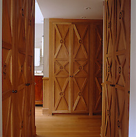 The X-pattern of the dressing room's oak cabinets were Moschino's way of adding interest to a very large space