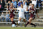 28 November 2008: Texas A&M's Micah Stephens (18) clears the ball from North Carolina's Casey Nogueira (54). The University of North Carolina Tar Heels defeated the Texas A&M University Aggies 1-0 in double overtime at Fetzer Field in Chapel Hill, North Carolina in a Fourth Round NCAA Division I Women's college soccer tournament game.