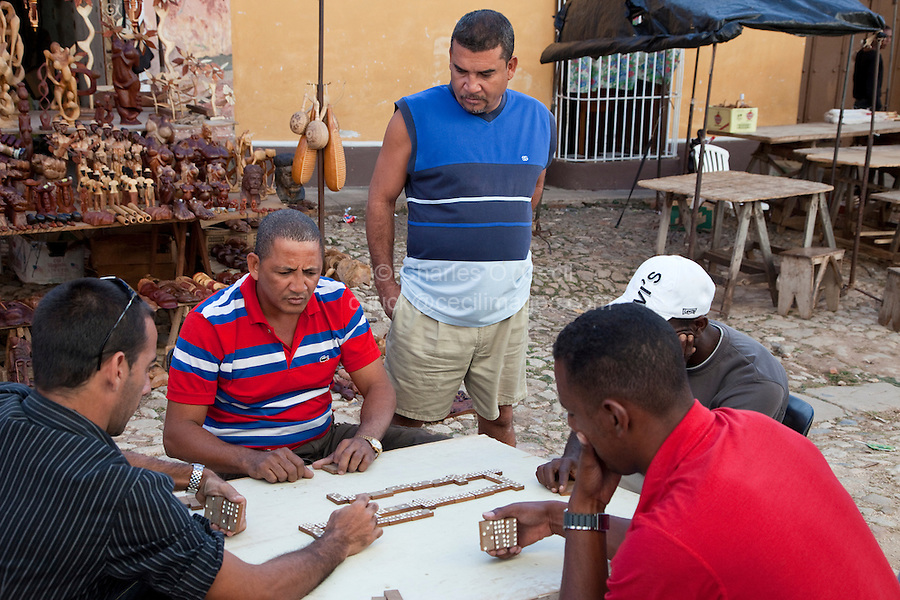 Cuba, Trinidad.  Men Playing Dominoes, Late Afternoon.