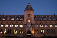 The Neo-gothic building of the Oxford Natural History Museum at dusk.