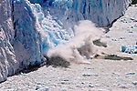 A large section of the wall of Glacier Perito Moreno gives way, plunging into the icy waters of Lago Argentina.