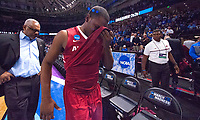 NWA Democrat-Gazette/J.T. WAMPLER Arkansas' Manuale Watkins wipes his face as he leaves the court with assistant coach Melvin Watkins after their game against North Carolina Sunday March 19, 2017 during the second round of the NCAA Tournament at the Bon Secours Wellness Arena in Greenville, South Carolina. The Tar Heels beat the Razorbacks 72-65 eliminating them from the tournament.