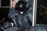 Moscow, Russia, 31/01/2011..Police force a demonstrator into a police wagon at a monthly Strategy 31 anti-government demonstration. Opposition activists hold regular demonstrations on the 31st day of the month, protesting against restrictions on the freedom of assembly, which is protected by article number 31 of the Russian constitution.