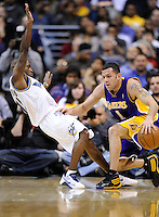Jordan Farmer of the Lakers is called for an offensive foul against Earl Boykins of the Wizards. Los Angeles defeated Washington 115-103 at the Verizon Center in Washington, DC on Tuesday, January 26, 2010.  Alan P. Santos/DC Sports Box