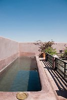 The long narrow swimming pool on the roof terrace offers a welcome restbite from the heat