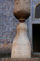 Detail of a pillar in the Tash Khauli Palace courtyard, 1830-38, Khiva, Uzbekistan, pictured on July 6 2010, in the afternoon. The courtyard is decorated with patterned blue and white tiles. Commissioned by Allah Kuli Khan the Tash Kauli palace is a huge complex containing 163 rooms which took its architects, Tajiddin and Kalandar, 10 years to build. The harem, occupying about half of the palace has 5 aiwan terraces, with delicately carved wooden pillars,  behind which were the quarters for the khan and his wives. Across the courtyard were the  concubines' apartments.  The facades and walls around the courtyards were decorated with traditional blue, ultramarine and white colours majolica made by Abdullah.