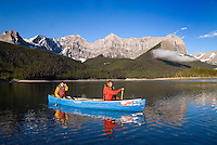 Kananaskis Country, Alberta, Canada, August 2008. Canoeist hit the water of uppel Kananaskis Lake at sunrise. The Kananaskis is a tranquil and green part of the Rocky Mountains. Away from the masses it offers many outdoor adventure possibilities. Photo by Frits Meyst/Adventure4ever.com