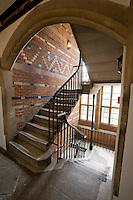 Oblique view of original stairwell through arch showing Keble brick work