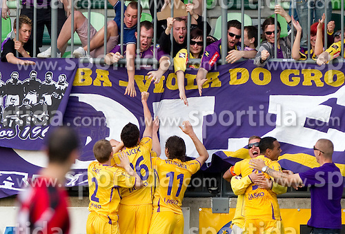 Viole and players of Maribor celebrate after second goal during football match between NK Primorje and NK Maribor of 1st Slovenian football league PrvaLiga, on May 21, 2011 in Ajdovscina, Slovenia. Maribor defeated Primorje 2-1 and became Slovenian national Champion 2010/2011. (Photo By Vid Ponikvar / Sportida.com)