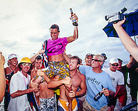 Snapper Rocks,Coolangatta, Queensland, Australia. Dean 'Dingo' Morrison (AUS) is carried up the beach by Joel Parkinson (AUS) and Phil MacDonald (AUS) after winning the Quiksilver Pro Gold Coast in 2003. Mick Fanning (AUS) in the blue T-Shirt supports Morrison on his way up the beach. Morrison, Parkinson and Fanning are the modern day 'Coolie Kids'. Photo: joliphotos.com