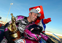 Oct. 28, 2012; Las Vegas, NV, USA: NHRA pro stock motorcycle rider Eddie Krawiec celebrates after winning the Big O Tires Nationals at The Strip in Las Vegas. Mandatory Credit: Mark J. Rebilas-