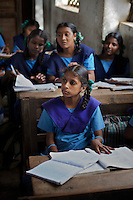 Bhanupriya Krishnamurthy (age 12) in class at the Government Girls High School, Venugopalapuram in Cuddalore. ..The five Krishnamurthy sisters from Pudupettai were placed in the Government Home for Tsunami Children in Cuddalore, Tamil Nadu when they lost their mother to the 2004 tsunami. Their father, Krishnamurthy, had decided he could no longer provide day-to-day care for his daughters. Krishnamurthy later remarried. The Krishnamurthy sisters now range in age from eight to sixteen...The four younger sisters are still at the Governement home (or orphanage). In summer 2009, Sivaranjini, the eldest aged sixteen, failed her 10th Standard exams and had to drop out of school so leaving her not eligible for care at the Government home. She is now living with her father and his new wife Nagamalli's house 30km away in Pudupettai. Krishnamurthy is intending that Sivaranjini marry a second cousin in 2010. ..Krishnamurthy visits the Government orphanage once a week to see his four younger daughters. Nagamalli is popular with all five sisters. She provides them attention when they are together and is genuinely interested in their well-being. Sivapriya remains close to her paternal aunt Kamasala with whom she used to live in the fishing village of Thazanguda. Kamasala visits Sivapriya at the orphanage every fortnight. The sisters return to their father's home for festivals including Diwali and the Pudupettai village temple festival...According to Revathi, the staff member in charge at the Government home, the absence of the elder Sivaranjini has had the effect of making the remaining four sisters still at the home increasingly independent. For instance, where they used to all sleep together the girls now sleep in different dormitories. The eldest of these four, fourteen year-old Sivapriya has adopted some of the responsibilities of her elder sisters including coordinating clothes washing and helping her younger siblings with school work. According to her class teacher at the lo