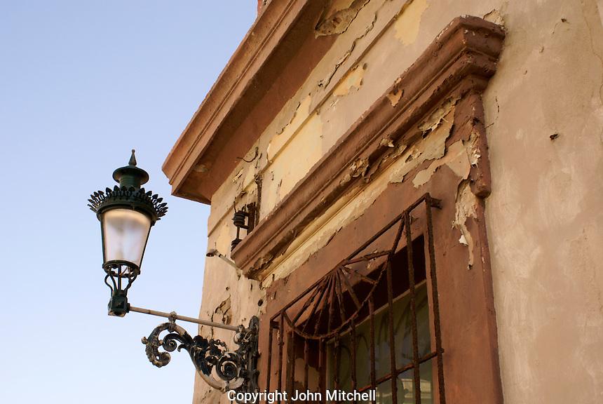 Metal lantern on the corner of a nineteenth century building in old Mazatlan, Sinaloa, Mexico