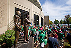 Sept. 28, 2013; Fans enter Notre Dame Stadium through the Lou Holtz gate past the eponymous statue.<br /> <br /> Photo by Matt Cashore/University of Notre Dame