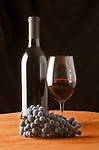 Cabernet grapes, glass and bottle