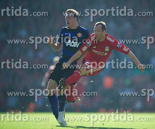 15.10.2011, Anfield, Liverpool, ENG, PL, FC Liverpool vs Manchester United, im Bild Liverpool's Charlie Adam in action against Manchester United's Phil Jones during the Premiership match at Anfield // during the Premier League football match between FC Liverpool vs Manchester United at Anfield stadium, liverpool, United Kingdom on 15/10/2011. EXPA Pictures © 2011, PhotoCredit: EXPA/ Propaganda Photo/ David Rawcliff +++++ ATTENTION - OUT OF ENGLAND/GBR+++++