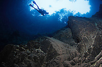 RB7619-D. Scuba diver (model released) swims alongside steep rock walls of Lagoa Misteriosa, a freshwater sinkhole more than 200m deep renowned for cave diving near Jardim, Brazil, South America.<br /> Photo Copyright &copy; Brandon Cole. All rights reserved worldwide.  www.brandoncole.com