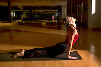 Woman practicing yoga in her workout room.