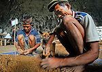 "Manggarai workers -- and their dog -- sift sediments from a Liang Bua excavation pit in search of tiny remains at the discovery site of Homo floresiensis. the Flores ""hobbit"""