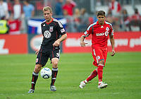 11 September 2010: D.C. United forward Daniel Allsopp #9 and Toronto FC defender Adrian Cann #12 in action during a game between DC United and Toronto FC at BMO Field in Toronto..DC United won 1-0..