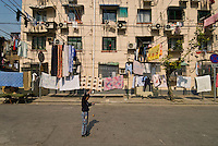Exterior of apartment building with hanging laundry, Shanghai, China