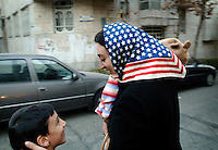 An Iranian Jewish woman wearing a Stars & Stripes headscarf as she leaves the synagogue. There are approximately 25,000 Jews in Iran, their number ever decreasing.