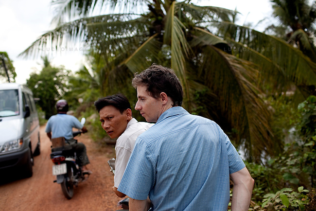 Gary Field-Mitchell on motorbike heading to look at the Tan Hoi Dong private enterprise in the Tan Thoi commune.
