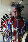 "Native American dressed in powwow regalia for pow wow in Washington DC A pow-wow (also powwow or pow wow or pau wau) is a gathering of North America's Native people. The word derives from the Narragansett word powwaw, meaning ""spiritual leader""."