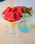 Gero Tsengas, a beautiful restaurant right on the water that serves fresh seafood. Kissamos, Crete, Greece, Europe. Pictured here is the raki served with fresh watermelon
