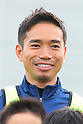 Nagatomo plays soccer with children during ABC-MART Soccer Clinique