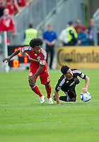 11 September 2010: D.C. United forward Pablo Hernandez #21 and Toronto FC midfielder Julian de Guzman #6 in action during a game between DC United and Toronto FC at BMO Field in Toronto..DC United won 1-0..