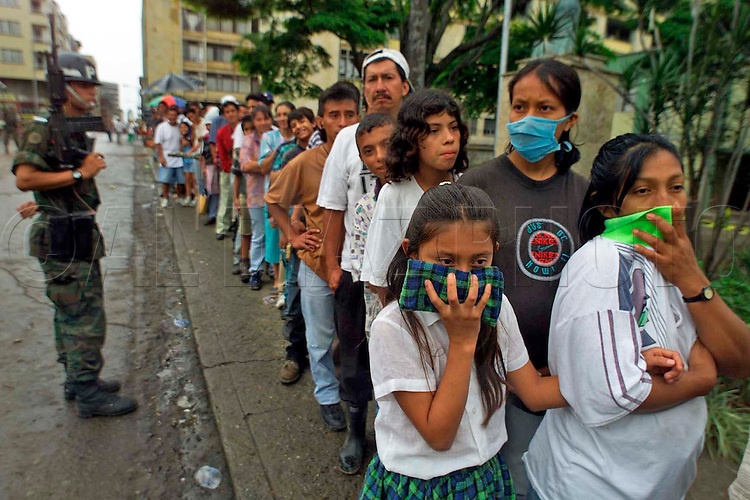 1/28/99--Al Diaz/Herald staff--Waiting in line for food is Lady Johanna12, with her mother Magdalena Tapasco in central Armenia. The line was at least three blocks long.<br /> Owner, Jorge Ivan Londo&ntilde;o of Ventanilla Verde store donated everything in his store to the victims of earthquake that struck Colombia on monday.