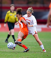 Jordan Roseboro (6) of Miami keeps control of the ball in front of Riley Barger (10) of Maryland during the game at Ludwig Field in College Park, MD.  Maryland defeated Miami, 2-1, in overtime.