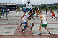 TH40711-D. Boys playing soccer in late afternoon in a public square in Havana city. Cuba.<br /> Photo Copyright &copy; Brandon Cole. All rights reserved worldwide.  www.brandoncole.com