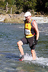 NELSON LAKES, NEW ZEALAND - APRIL 18:  David Young crosses the Travers River during the 2015 Alpine Lodge Loop The Lake trail run at Lake Rotoiti on April 18 16, 2015 in Nelson, New Zealand. (Photo by Marc Palmano/Shuttersport Limited)