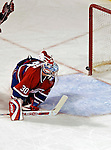 6 February 2007: Montreal Canadiens goaltender David Aebischer of Switzerland watches the puck hit the goal-post, denying the Carolina Hurricanes a scoring chance in the first period at the Bell Centre in Montreal, Canada. The Hurricanes went on to defeat the Canadiens 2-1.....Mandatory Photo Credit: Ed Wolfstein *** Editorial Sales through Icon Sports Media *** www.iconsportsmedia.com