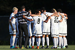 26 August 2016: Wake Forest head coach Bobby Muuss (in striped shirt) huddles with his starters before the game. The Wake Forest University Demon Deacons hosted the Saint Louis University Billikens in a 2016 NCAA Division I Men's Soccer match. SLU won the game 1-0.