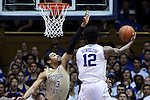 04 February 2015: Duke's Justise Winslow (12) shoots over Georgia Tech's Robert Sampson (13). The Duke University Blue Devils hosted the Georgia Tech Yellow Jackets at Cameron Indoor Stadium in Durham, North Carolina in a 2014-16 NCAA Men's Basketball Division I game. Duke won the game 72-66.