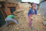 People clean up rubble in Dhawa, a village in the Gorkha District of Nepal that was hard hit by the 2015 earthquake.