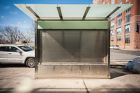 A vacant Cemusa newsstand in New York on Saturday, February 25, 2017. New York City contracted with Cemusa, a Spanish advertising company, which was eventually purchased by the French JCDecaux SA to commoditize sidewalks by upgrading newsstands, payphone kiosks and public toilets with advertising. (© Richard B. Levine)