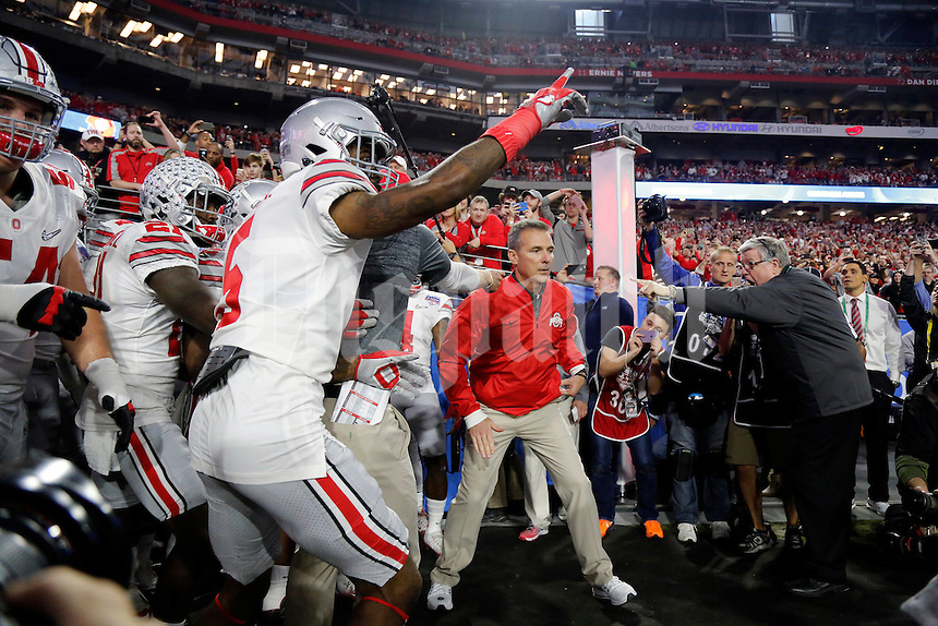 Ohio State Buckeyes head coach Urban Meyer and the Buckeyes take the field before the game of the College Football Playoff semifinal Fiesta Bowl against the Clemson Tigers at University of Phoenix Stadium in Glendale, Arizona on Dec. 31, 2016.