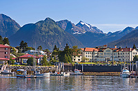 View across the Sitka Harbor, from Japonski Island, overlooking the coastal fishing community of Sitka, on Baranof Island, southeast, Alaska. Commercial fishing vessel, &quot;Swift&quot; passes through Sitka Channel.