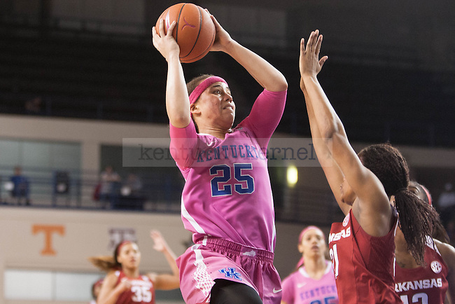Junior guard Makayla Epps (25) shoots the ball over a defender during the game against the Arkansas Razorbacks on Sunday, February 21, 2016 in Lexington, Ky. Kentucky won the game 77-63. Photo by Hunter Mitchell | Staff