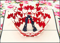 BNPS.co.uk (01202 558833)<br /> Pic: TomWren/BNPS<br /> <br /> One of the four cards that are avaliable to send to loved ones for Valentine's Day.<br /> <br /> A British village is cashing in on the cupid effect this Valentine's Day by launching its own postal service so anyone can send a card from the 'world's most romantic village'.<br /> <br /> The tiny village of Lover in Wiltshire has launched the 'Lover Post' with limited edition cards and a special post mark showing it has been sent from the tender-hearted village.<br /> <br /> The quirky gimmick is part of a campaign to save the once-thriving village for the local community.