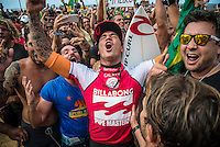 Pipeline, North Shore of Oahu, Hawaii Friday December 19 2014) Gabriel Medina (BRA) and Alejo Muniz (BRA) embrace after Medina has won the world title.- The final stop of the 2014  World Championship Tour, the Billabong Pipe Masters in Memory of Andy Irons, was  ccompleted today in NW double overhead surf. <br /> Gabriel Medina (BRA) became the first ever Brazilian World Champion after both rival contenders , Kelly Slater (USA) and Mick Fanning (AUS) were eliminated from the contest. Medina went onto finish 2nd overall behind Julian Wilson (AUS). <br /> In the overlapping heat format Wilson surf three consequent heats and still had enough entry to take out the 30 minute final.<br /> By winning the final Wilson also won the covered Vans Triple Crown of Surfing for best overall performance through the whole Triple Crown.<br /> <br /> The Billabong Pipe Masters in Memory of Andy Irons will determine this year&rsquo;s world surfing champion as well as those who qualify for the elite tour in 2015. As the third and final stop on the Vans Triple Crown of Surfing Series  the event will also determine the winner of the revered three-event leg.<br /> <br />  Photo: joliphotos.com